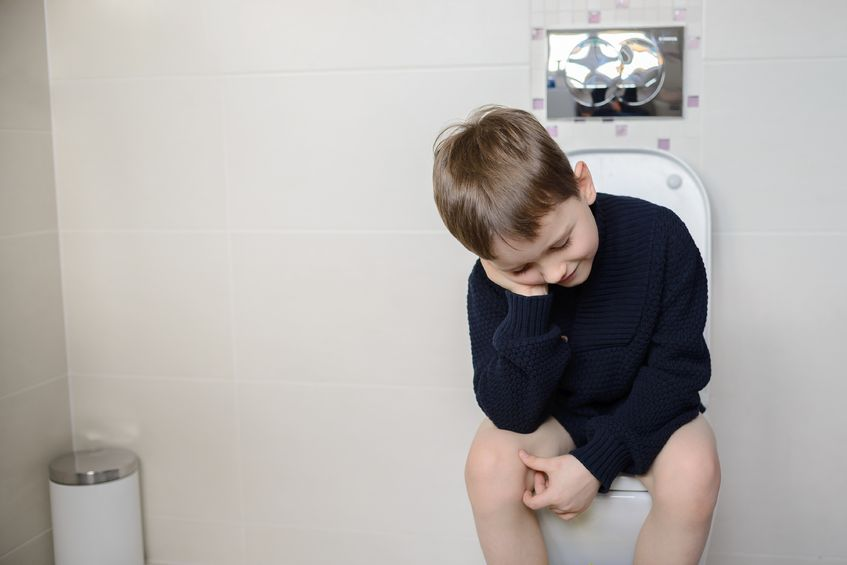 50876347 - thoughtful 6 year old child sitting on the toilet